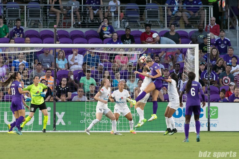 Orlando Pride defender Alanna Kennedy (14) heads in the ball off a set piece for the game's first goal.