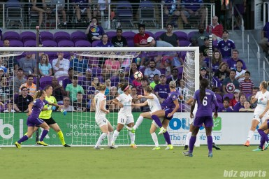 FC Kansas City and Orlando Pride players look on as Orlando Pride defender Alanna Kennedy's header travels to the back of the net.