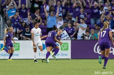 Orlando Pride defender Alanna Kennedy (14) celebrates her goal with teammates.