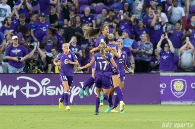 The Orlando Pride celebrating teammate Alanna Kennedy's goal.