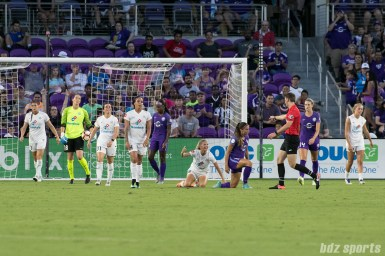 The FC Kansas City team is in disbelief as FC Kansas City defender Katie Bowen (6) is called for a foul inside the penalty box, awarding Orlando Pride a penalty kick.