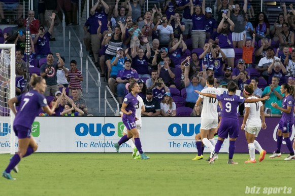 Orlando Pride forward Alex Morgan (13) celebrates her successful penalty kick with teammates.