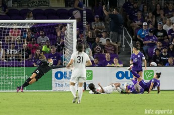 Orlando Pride goalkeeper Aubrey Bledsoe (19) gets her fingertips on the ball to push it just wide of the goal.