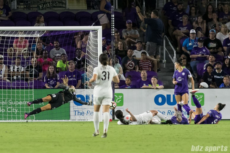 FC Kansas City and Orlando Pride look on as FC Kansas City forward Sydney Leroux's (14) shot gets pushed just outside the goal post.
