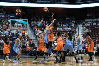 Chicago Sky center Stefanie Dolson (31) and Connecticut Sun center Jonquel Jones (35) take the opening tip.