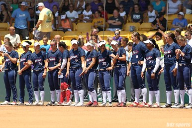 The USSSA Pride line up along the third base line during team announcements