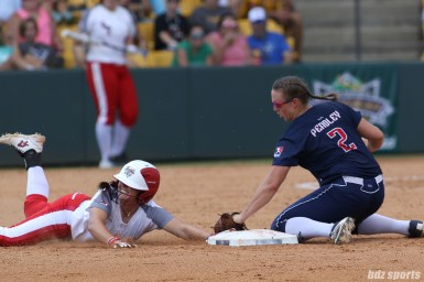 Scrap Yard Dawgs Hannah Flippen (1) slides into second base and beats the tag from USSSA Pride shortstop Shelby Pendley (2)