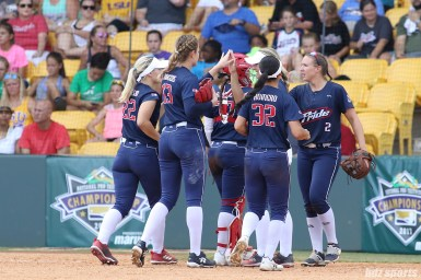The USSSA Pride high five at the end of the inning