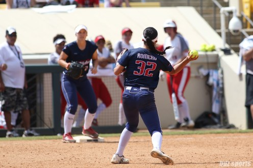 USSSA Pride second baseman Sierra Romero (32) makes a throw to first base