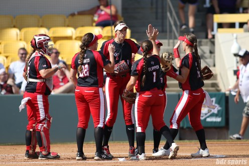 Scrap Yard Dawgs pitcher Monica Abbott (14) high fives second baseman Hannah Flippen (1) prior to the start of the bottom of the inning