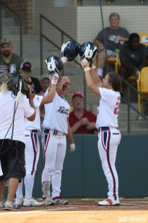 USSSA Pride Kelly Kretschman (12) and Megan Wiggins (25) tap helmets after Wiggins hit a home run in the bottom of the first inning
