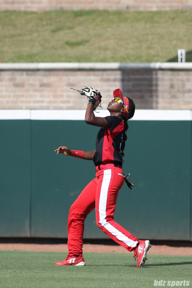 Scrap Yard Dawgs infielder Kayla Winkfield (9) gets under the ball to make a catch for the out