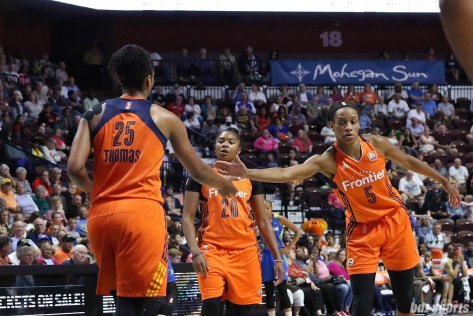 Connecticut Sun guard Jasmine Thomas (5) slaps hands with teammate Alyssa Thomas (25)