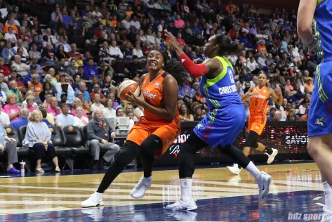 Connecticut Sun forward Morgan Tuck (33) drives to the basket