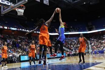 Connecticut Sun center Jonquel Jones (35) blocks the shot
