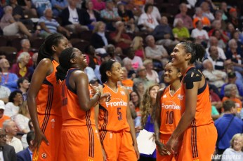 Connecticut Sun forwards Shekinna Stricklen (40) and Alyssa Thomas (25) share a laugh waiting to come back from a timeout break