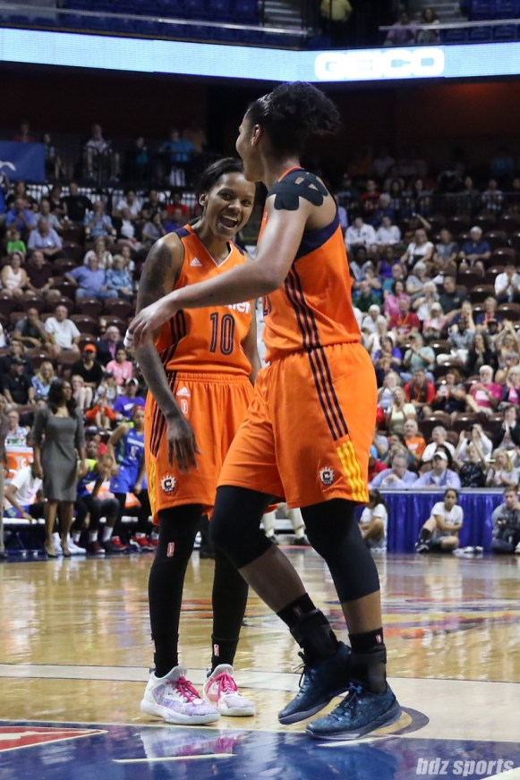 Connecticut Sun Courtney Williams (10) pumps up teammate Alyssa Thomas (25)