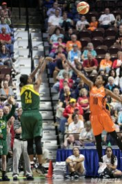 Seattle Storm guard Jewell Loyd (24) release a 3-point shot ofer the arm of Connecticut Sun guard Courtney Williams (10).