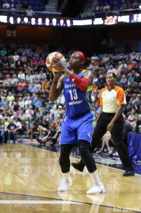 Dallas Wings forward Karima Christmas-Kelly (13) looks to release a 3-pointer