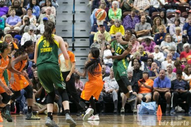 Seattle Storm guard Jewell Loyd (24) dishes off a pass to teammate Breanna Stewart (30).
