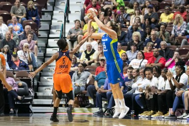 Dallas Wings forward Theresa Plaisance (55) releases a shot from behind the arc.