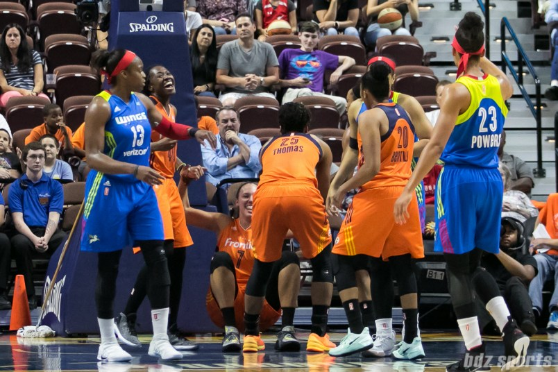 The Connecticut Sun help to pickup teammate Kayla Pedersen (7) after she is awarded an offensive foul.