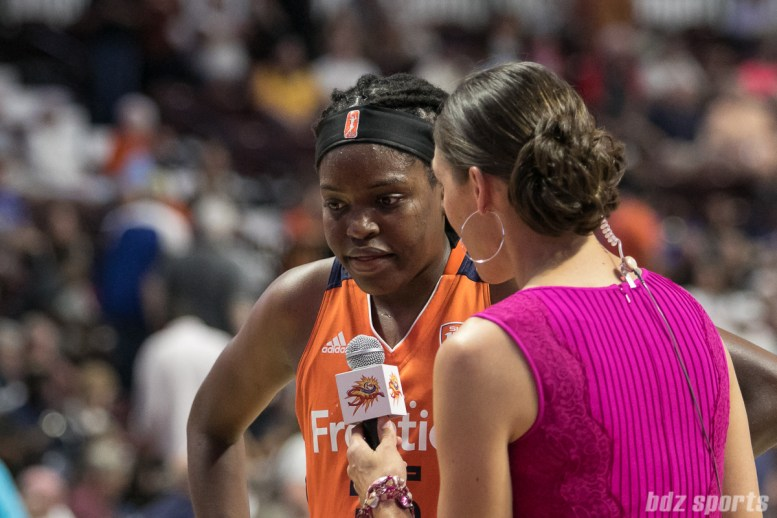 Connecticut Sun center Jonquel Jones (35) is interviewed by Rebecca Lobo at the end of the first half.