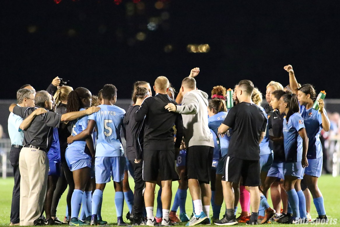 The Sky Blue FC huddles after their 1 - 0 win over the Boston Breakers