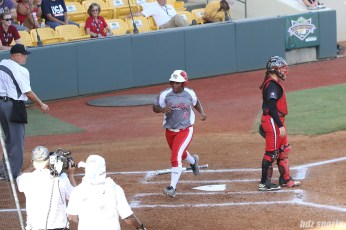 Scrap Yard Dawgs second baseman Nerissa Myers (15) scores the first run of the game.