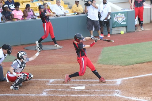 Akron Racers infielder Sam Fischer (52) at bat