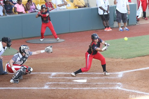 Akron Racers outfielder Nicole Schroeder (29) lays down a bunt