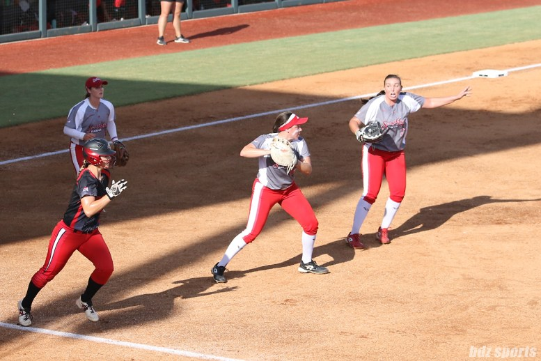 Scrap Yard Dawgs infielder Brittany Cervantes (22) looks to make a throw to second