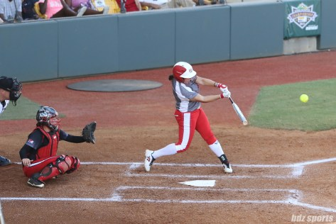 Scrap Yard Dawgs infielder Hannah Flippen (1) makes contact with the ball