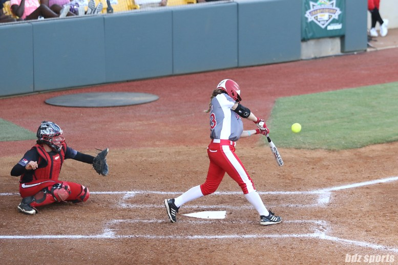 Scrap Yard Dawgs outfielder Allexis Bennett (43) makes contact with the ball