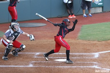Akron Racers outfielder A.J. Andrews (9) at bat