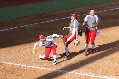 Scrap Yard Dawgs infielder Kasey Cooper (31) makes a throw to first