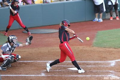 Akron Racers shortstop Sami Fagan (5) makes contact with the ball for a homerun