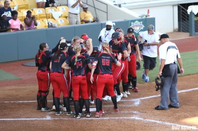 The Akron Racers greet teammate Sami Fagan (5) at home plate after her homerun