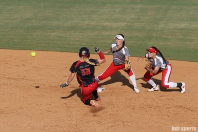 Akron Racers infielder Sam Fischer (52) beats the throw to steal second base