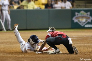Scrap Yard Dawgs shortstop Ali Aguilar (11) gets the tag out at second base
