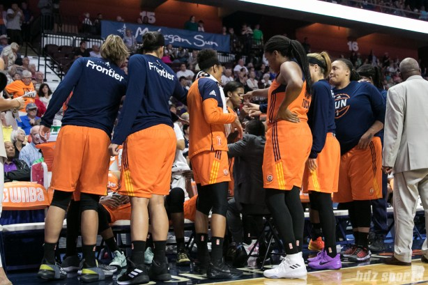 The Connecticut Sun huddle with hands in prior to the game restarting.