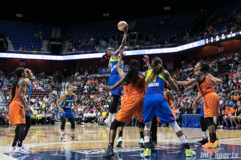 Dallas Wings forward Karima Christmas-Kelly (13) gets her hand on the ball during a jump ball.