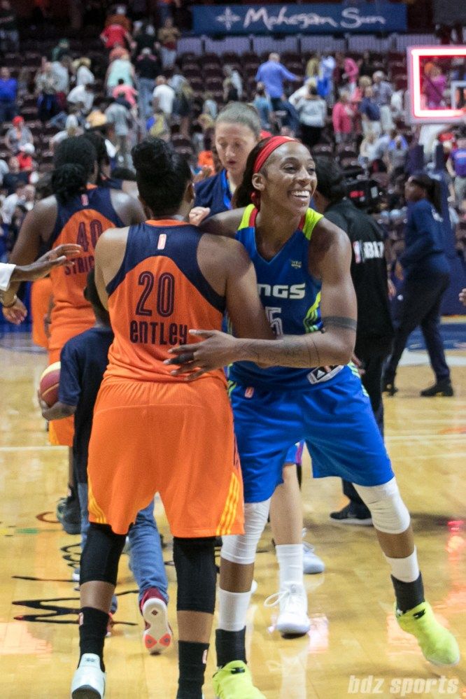 Dallas Wings forward Glory Johnson (25) congratulates Connecticut Sun guard Alex Bentley (20) after the game.