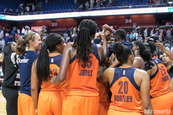 The Connecticut Sun huddle post-game after defeating the Dallas Wings 96-88.