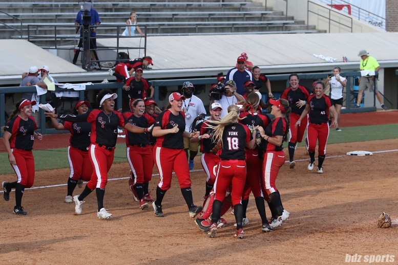 Scrap Yard Dawgs celebrate their 5 - 2 win over the USSSA Pride in game 3 of the NPF Championship Final to capture their first Cowles Cup