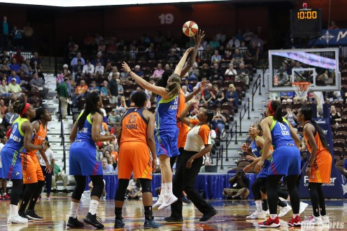 Dallas Wings forward Theresa Plaisance (55) takes the tip off against Connecticut Sun center Jonquel Jones (35)