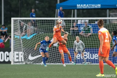 Houston Dash midfielder Amber Brooks (12) heads the ball.