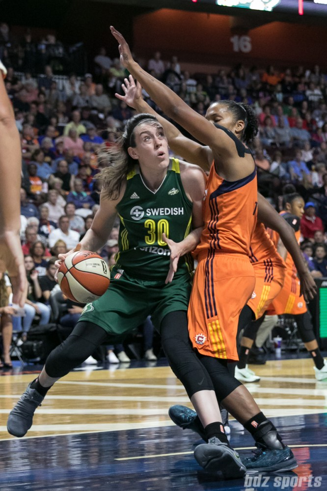 Seattle Storm forward Breanna Stewart (30) drives to the basket while being defended by Connecticut Sun forward Alyssa Thomas (25).