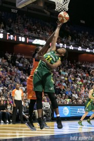 Seattle Storm guard Jewell Loyd (24) stretches out to get her fingertips on a rebound.