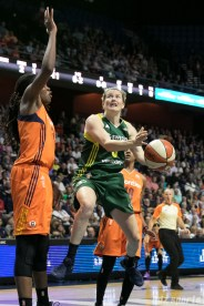 Seattle Storm guard Sami Whitcomb (3) drives down the lane to the basket against the Connecticut Sun.